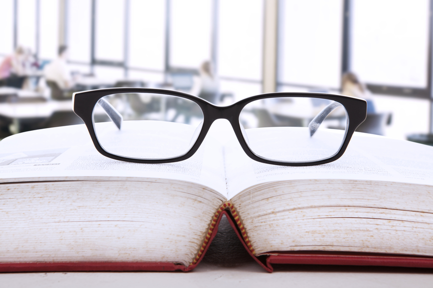 glasses on a book representing client research
